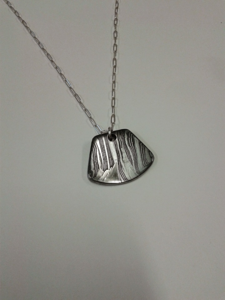 $70 - Damascus and Silver Pendant (shape can vary- pendant only)